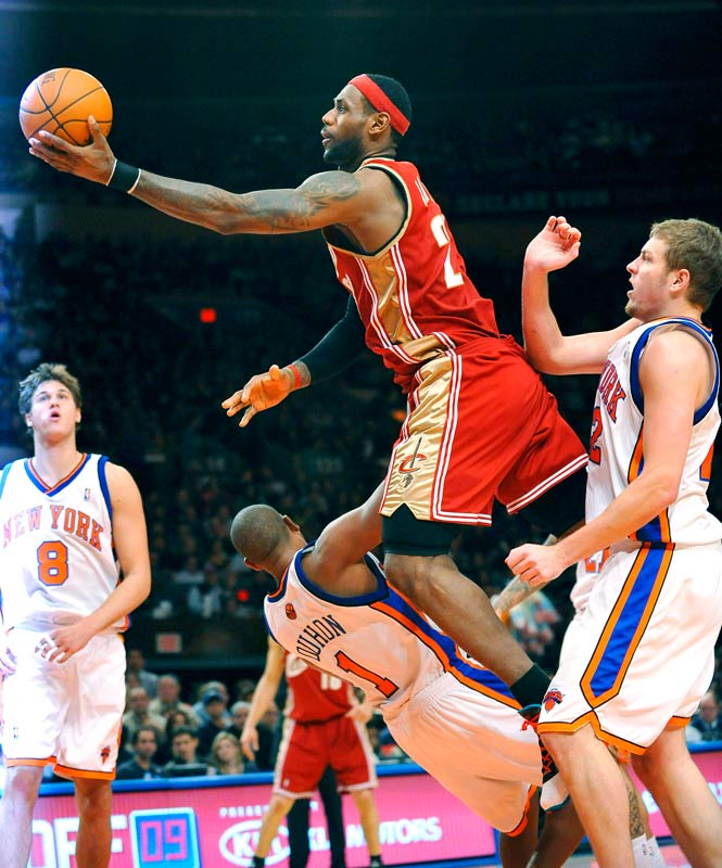 LeBron James drives to the basket over New York's Chris Duhon and David Lee at Madison Square Garden on Nov. 6. In Cleveland's only regular season visit to New York, the Cavs prevailed 100-91.