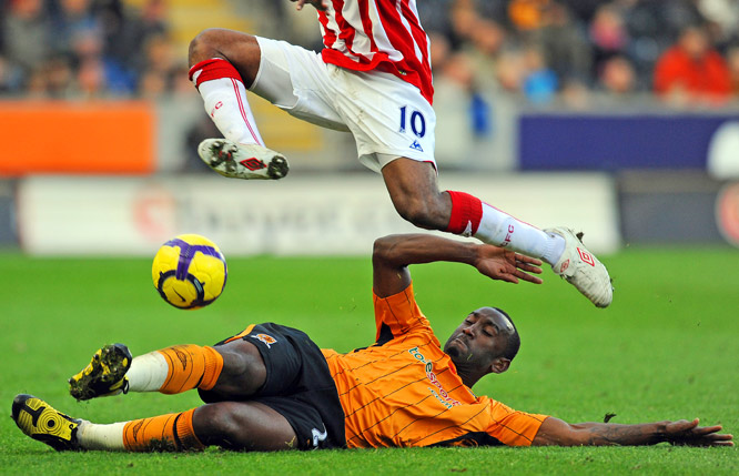 Guinean defender Kamil Zayatte tackles Jamaican forward Ricardo Fuller during the English Premier League match between Hull City and Stoke City on Nov. 8.