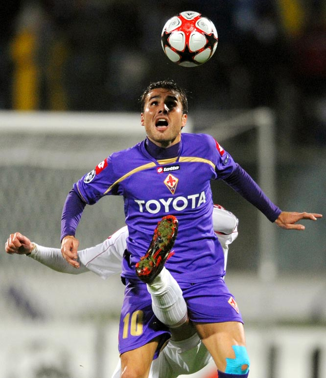 Fiorentina's Adrian Mutu heads the ball despite a Debrecen player's upwardly mobile leg during their Group E Champion's League match on Nov. 4. Fiorentina won 5-2.