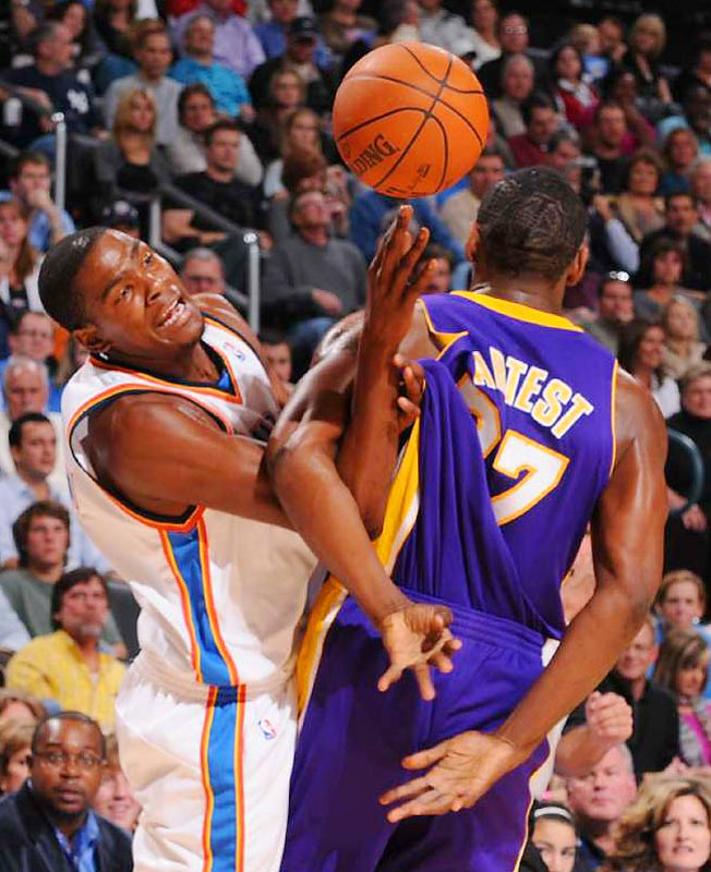 Kevin Durant of the Oklahoma City Thunder wrestles for the ball with Ron Artest of the Los Angeles Lakers on Nov. 3. Los Angeles got the road win in overtime, 101-98.