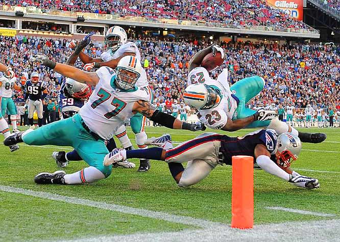 New England safety Brandon McGowan stops Miami's Ronnie Brown from scoring on Nov. 8 in Foxboro. Brown threw a scoring pass later in the series, one of two  Dolphins' touchdowns in the 27-17 loss.