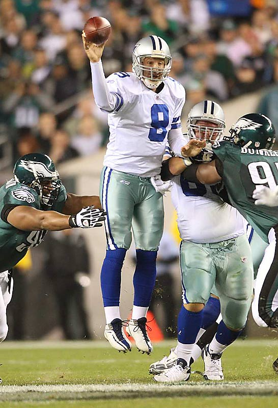 Dallas quarterback Tony Romo jumps to get off a pass before the Philadelphia pass rush can get to him. The Cowboys moved into first place in the NFC East with their Sunday night victory over the Eagles.