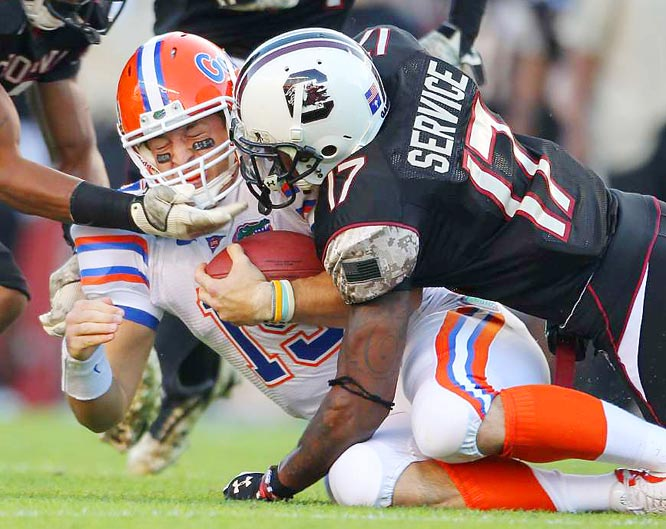 Florida quarterback Tim Tebow is tackled by Chris Culliver of South Carolina at William-Brice stadium in Columbia on Nov. 14. Florida defeated South Carolina 24-14.