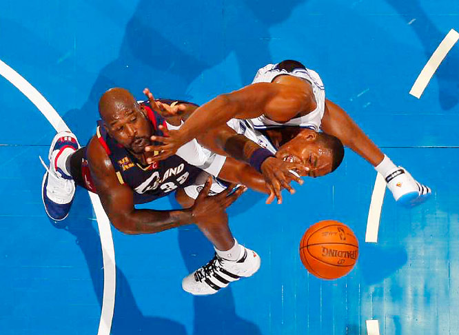 The earth shook on Nov. 11 when Eastern Conference behemoths Shaquille O'Neal of theCavaliers (left) and Dwight Howard of the Magic collided in the lane at Amway Arena in Orlando. Inaddition to pain and frustration, Howard drew afoul on his way to the basket. Cleveland won the game 102--93.