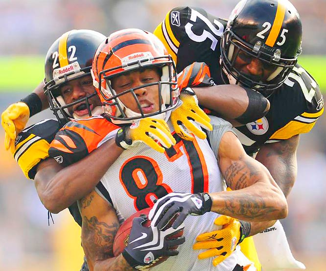 Cincinnati wide receiver Andre Caldwell is tackled by Pittsburgh Steelers William Gay (22) and Ryan Clark (25) during their game at Heinz Field on Nov. 15.