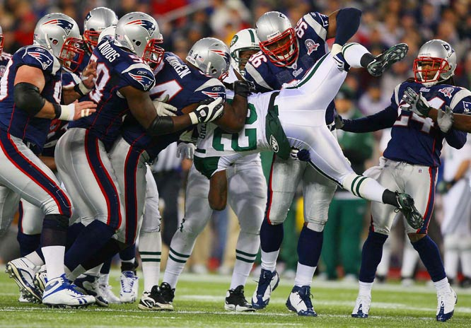 Linebacker Adalius Thomas (96) of the Patriots lifts Jets running back Shonn Greene off the ground while making a tackle in New England's 31-14 home win.