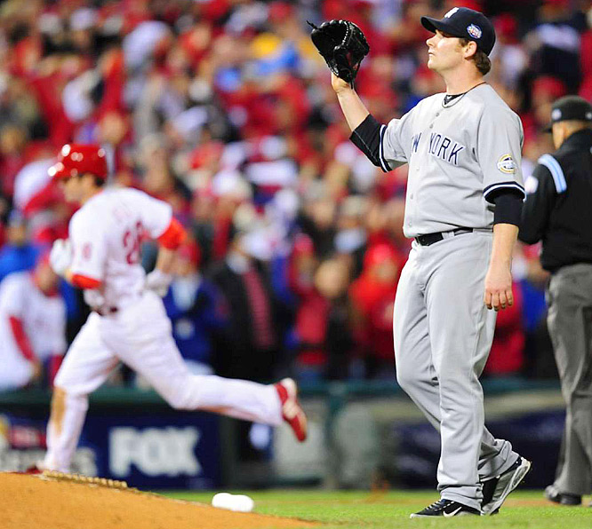 New York reliever Phil Coke tries to regain his composure after Chase Utley (rounding the bases) took him deep.