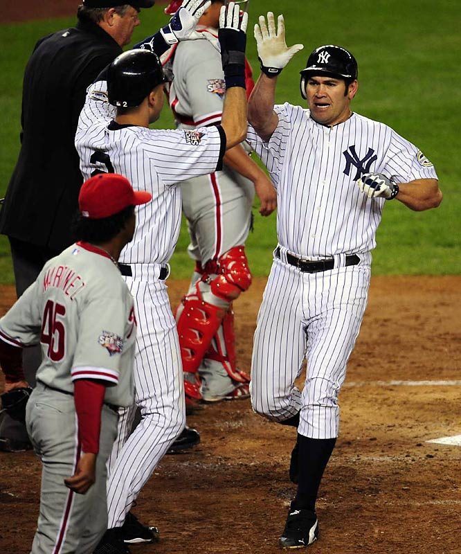 Johnny Damon and Derek Jeter exchange a high five after scoring in the third, but Damon had to leave the game after that because of a pulled muscle.