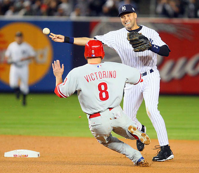 Derek Jeter turns a double play to get the Yankees off the field in the first.