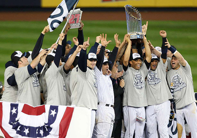 The jubilant Yankees gather for a team shot after defeating the Phillies in Game 6.
