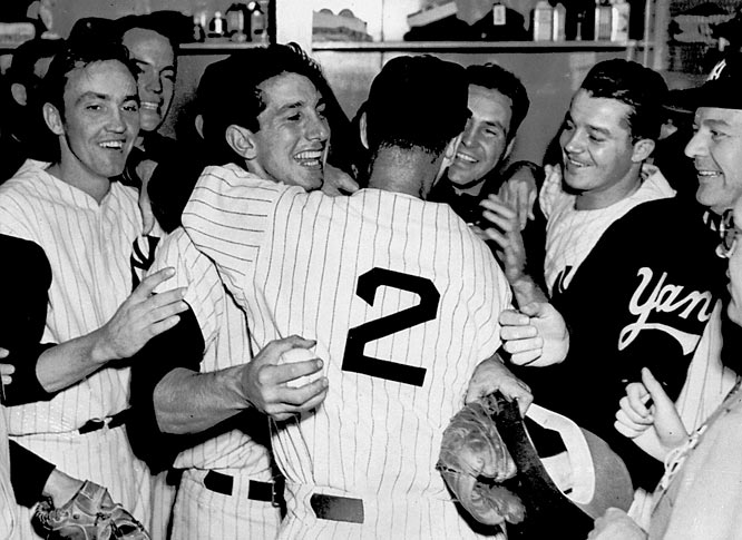 """If they had eight Babe Ruths, they couldn't beat us,"" Billy Martin (being hugged by Frank Crosetti, No. 2) said of the Dodgers. The brash second baseman earned Series MVP honors by batting .500 (12 for 24) with a double, a pair of triples, two home runs, and eight RBI in the six games as the Yankees won their record fifth successive championship."