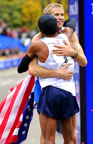 Ryan Hall greeted Meb Keflezighi (8) at the finish line. Hall, who trains with Keflezighi, finished fourth in 2:10:36 and was one of six Americans to finish in the top 10.