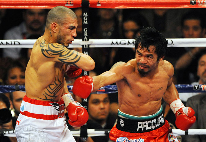 Filipino sensation Manny Pacquiao (red trunks), the top pound-for-pound fighter in the world right now, won his seventh title in as many weight classes by defeating WBO welterweight champion Miguel Cotto in Las Vegas on Saturday. Here are some of the best images from the Fight of the Year.