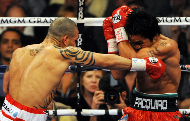 Cotto, who dropped down to 145 pounds to face Pacquiao, still held a height advantage. His typically devastating punches, though, did little to shake up Pacquiao.