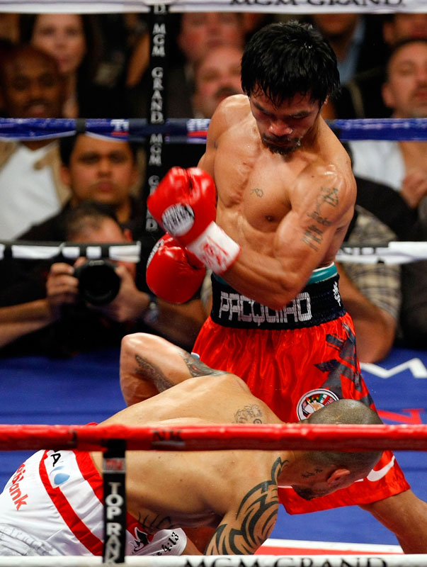 Pacquiao (50-3, 38 KOs) scored his second knockdown in the fourth as he continued to batter Cotto with dynamic combinations.