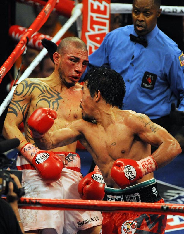 After getting Pacquaio along the ropes early in the fight, Cotto had the the tables turned on him as Pacquiao peppered him with punches.