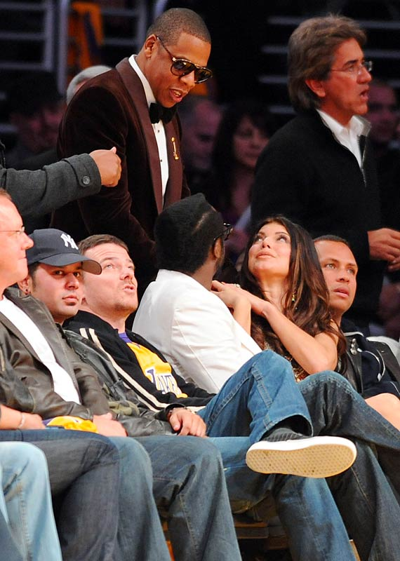 """A tuxedo-clad Jay-Z made a grand entrance in the second half of Sunday's Lakers-Thunder game when he walked over from the American Music Awards, which were taking place across the street from Staples Center. Jay-Z stayed for only a quarter before leaving for an AMA after-party. """"Only in Los Angeles,"""" Lakers guard Shannon Brown said after the game. """"Only in Los Angeles."""""""
