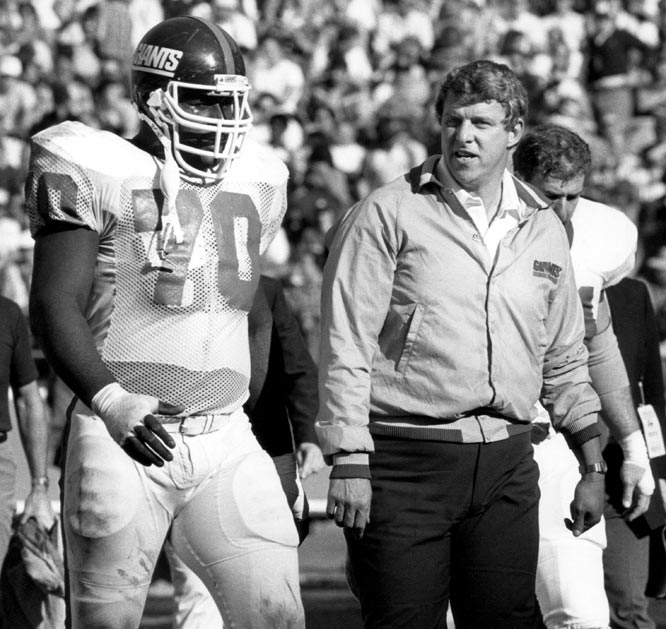 Bill Parcells talks with Leonard Marshall during the Giants' NFC Wildcard Playoff game against the Rams in 1984.