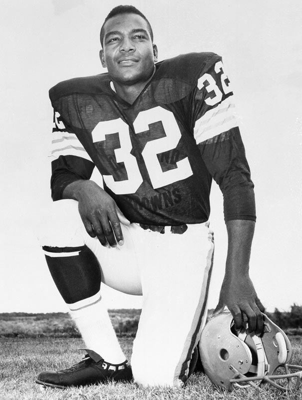 Cleveland's Jim Brown sets an NFL season rushing record of 1,163 yards after only eight games.