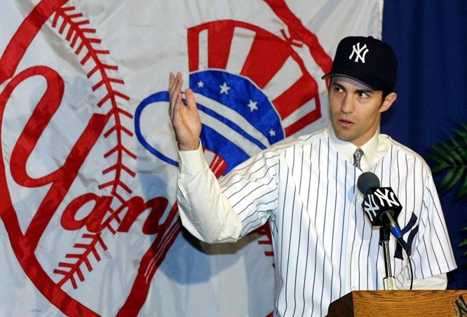 Free agent Mike Mussina inks an $88.5 million, six-year contract with the Yankees. The ten-year veteran compiled a 147-81 record with a 3.53 ERA as an Oriole hurler.