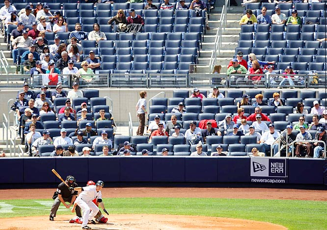 The new, $1.5-billion Yankee Stadium opened with a top ticket price of $2,500 for a field-level perch that included concierge service and a lavish pre-game spread. It was hard to miss the fact that the seats were mostly empty game after game while the nation's economic meltdown raged. By the end of April, the team had reduced the fee to a more modest $1,250.
