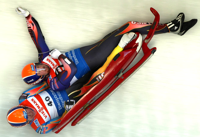 "Matt Mortensen (top) and Preston Griffall of the U.S. crashed during a training run on Feb. 19 in Whistler, B.C.The two hope to compete at the 2010 Winter Olympics in Vancouver.<br><br>""The sleds fly by at over 90 mph, so you need to really pay attention to the sounds. When I heard the scraping of metal on the ice and the banging of the sled off the walls of the track, I knew that someone had flipped, and I timed my shot as they passed through the curve. "" -- Photographer Jonathan Ferrey/Getty Images"