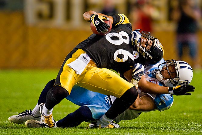 "With a tight grip on Hines Ward's chin and shoulder, Titans cornerback Cortland Finnegan wrestled the Steelers wide receiver to the ground during the two teams' season opener in Pittsburgh on Sept. 10.<br><br>""A play like this occurs a few times a game. This is where the true brutality of football is revealed: grotesquely bent ankles and knees, wrenched necks. It's amazing these players get up off the ground as often as they do."" -- Photographer Al Tielemans/SI"