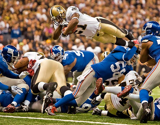 "Saints running back Mike Bell dived over the Giants' defensive line for a two-yard touchdown during a showdown between undefeated NFC teams at the Superdome on Oct. 18. Bell had 15 carries for 34 yards and that one TD in the Saints 38-27 victory.<br><br>""All I remember is that it happened very quickly, right at the beginning of the game. I'm always looking for an image like this, but over an NFL season there is usually only one chance to get it."" -- Photographer Simon Bruty/SI"