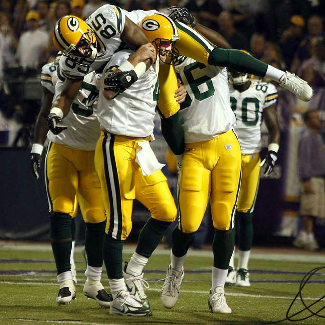 Favre's record-breaking 421st touchdown pass went to Greg Jennings in a 23-16 victory over the Vikings. The fact that Vikings fans, longtime haters of anything Packers, stood and applauded Favre for passing Dan Marino in the record book speaks volumes about his achievement. Two weeks earlier, Favre broke John Elway's mark for career victories by a quarterback, but the touchdown mark, given Favre's gunslinger mentality, was a more significant milestone.