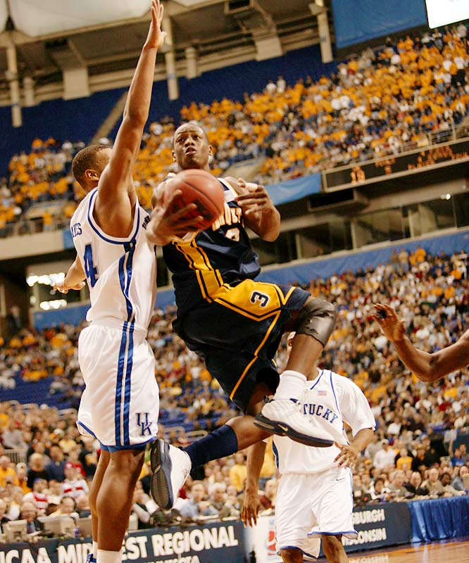 Wade was already an All-America but he really made a name for himself when he almost single-handedly ended Kentucky's 26-game winning streak by posting the fifth triple-double in NCAA tournament history: 29 points, 11 assists and 11 rebounds in the Midwest Regional final to lead Marquette to its first Final Four in 26 years.