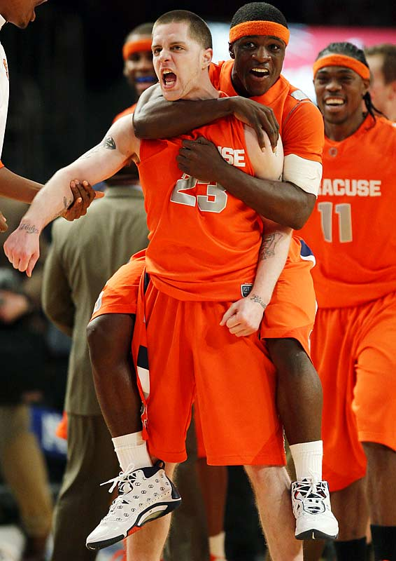 The Orange and the Huskies thrilled a late-night crowd at Madison Square Garden with a 3-hour, 46-minute game for the ages in the tournament quarterfinals. It nearly ended in regulation on a three-pointer by Syracuse's Eric Devendorf, but officials correctly ruled the ball was still in his hands when the clock expired. The Orange didn't grab their first lead of any extra session until the sixth and final overtime, when they finally pulled away to win the longest game in conference history. Before the final buzzer at 1:22 a.m., eight players had fouled out and six had recorded double-doubles.