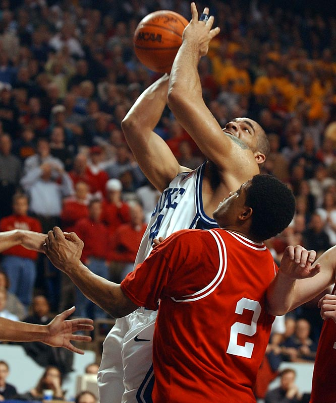 This could have made our Games of the Decade list. Down 17 midway through the first half against the top-seeded and defending national champion Blue Devils, the Hoosiers clamped down on defense and survived a wild finish to reach the Elite Eight for the first time since 1993. With Duke trailing by four, Jason Williams made a three-pointer while being fouled with 4.2 seconds left, but he missed the potential game-tying free throw and Carlos Boozer couldn't convert a putback.