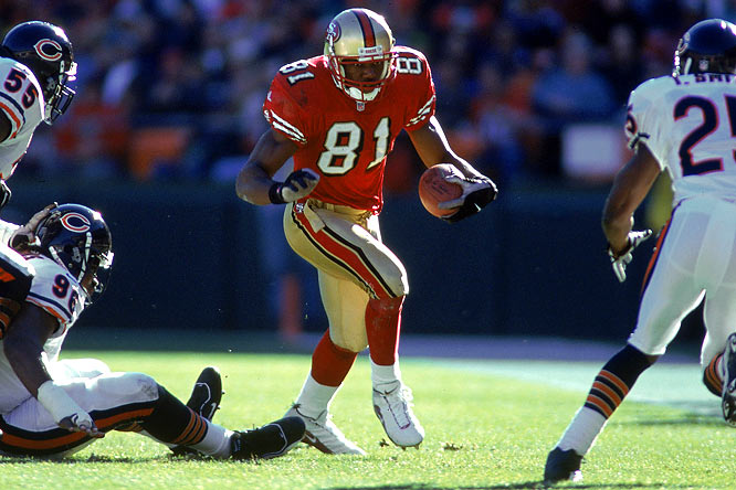 In Jerry Rice's final home game as a Niner, Owens stole the show. He broke a 50-year-old league record with 20 catches (for 283 yards) in a 17-0 victory against the Bears. T.O.'s mark held up for nine years (see next photo).
