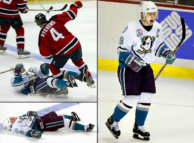"In the second period of Game 6 of the Stanley Cup Final, the diminutive Ducks winger was knocked woozy by a booming check at center ice by rugged Devils defenseman Scott Stevens. Kariya, who had set up two goals in the first period, lay on the ice for a minute or so before he was helped to the dressing room on rubber legs. He returned less than five minutes later and scored a goal to help the Ducks win, 5-2. ""It definitely showed a lot of grit for him to come back from a hit like that,"" Devils goalie Martin Brodeur said. ""There's not too many guys who can do that."""
