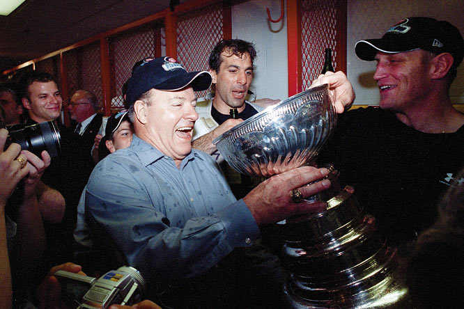 The Hall of Fame coach hoisted his record ninth Stanley Cup, and third with Detroit, after a 3-1 win over Carolina in Game 5 of the final. Bowman's guidance made the Red Wings the first team to ever win the Cup after falling into a two-games-to-none hole in the first round of the playoffs. (They went 16-5 the rest of the way.) The championship was also the first for longtime veterans such as goaltender Dominik Hasek and left wing Luc Robitaille.