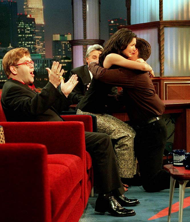 NFL cornerback Jason Sehorn surprised actress Angie Harmon by coming on stage during her interview with Jay Leno, getting on one knee and popping the question. The two married on June 9, 2001.