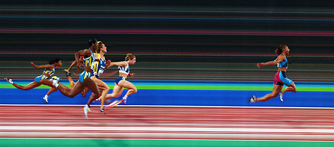 """This is Marion Jones wining the 100 meter final in Sydney.  After months of working to perfect the technique and planning, everything came together exactly when Marion pulled away from the field. It allowed [fellow photographer] David Callow and me to create a unique and powerful image."""