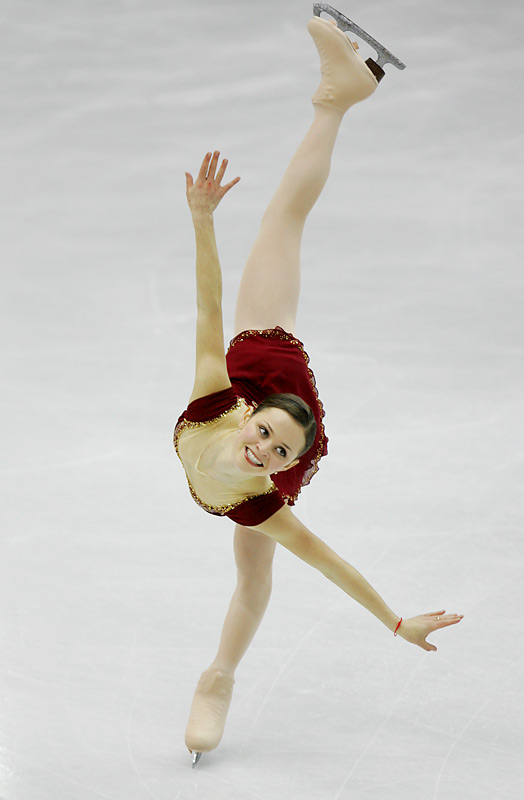 """During the long program, it's always a debate whether to shoot high for a pristine ice background, or low, which offers a more dramatic visual but a cluttered background. Here's a counterpoint to my remote shot from overhead, with Sasha Cohen during her long program coming right at the camera."""