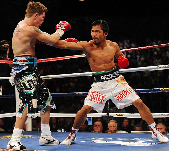 """In what was expected to be the stiffest test of Pacquiao's career, the Filipino icon deposited Hatton on the canvas twice in the first round before leaving him, well, stiff after a savage left cross in the second. """"I think that's the hardest punch I have ever landed,"""" Pacquiao said.<br><br>Runner-up: Arthur Abraham KOs Jermain Taylor"""