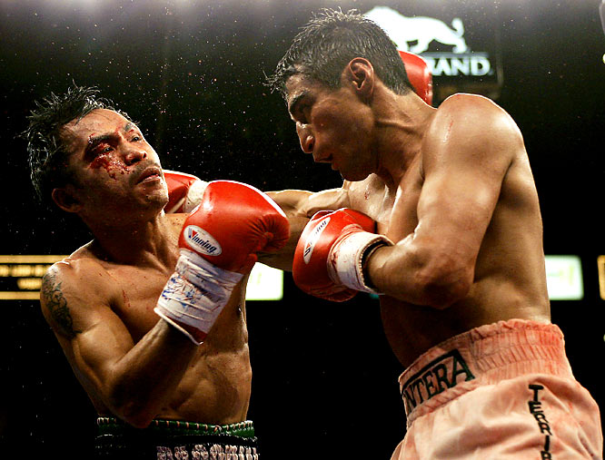 Manny Pacquiao moved up from featherweight to face Mexican legend Erik Morales at 130 pounds. In the first and best fight of their mid-decade trilogy, Morales got the best of the Filipino southpaw in a unanimous decision. Despite a comfortable lead on the scorecards, Morales went toe to toe with Pacquiao in the 12th -- cementing his warrior reputation.