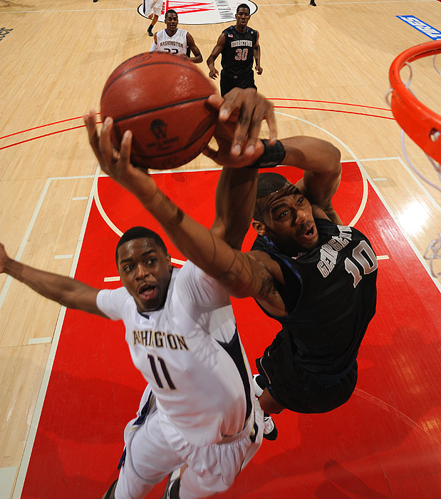Georgetown's Greg Monroe grabs a rebound over Washington's Matthew Bryan-Amaning during the Hoyas 74-66 victory on Dec. 12 in the Wooden Classic in Anaheim. No. 15 Georgetown improved to 8-0 while No. 17 Washington is now 6-2.