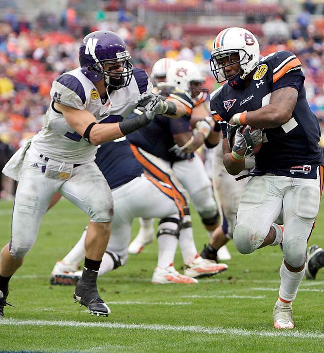 Ben Tate (right) rushed for 108 yards and two fourth-quarter touchdowns to lead Auburn (8-5). The Tigers finished their first season under Gene Chizik with the second-most wins by a first-year coach in school history. Mike Kafka completed 47 of 78 passes for four TDs for Northwestern, which failed on a version of the old fumblerooskie in overtime.