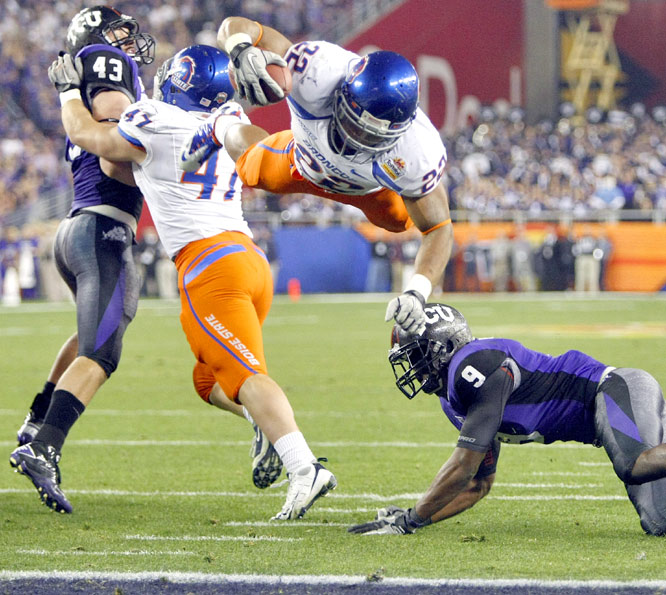 Boise State reached into its bag of tricks again and stunned Texas Christian in a Fiesta Bowl duel of unbeaten BCS busters. After the Broncos pulled off a gutsy fake punt at their own 33-yard line, Doug Martin (left) scored the decisive touchdown to give No. 6 Boise State the win.