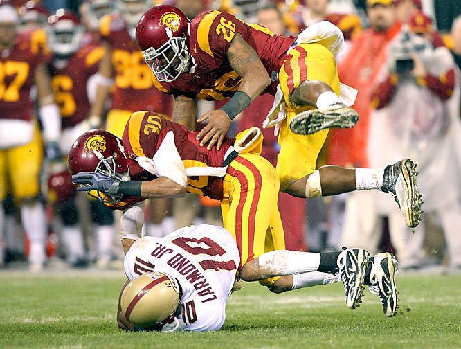 Matt Barkley threw touchdown passes to Stanley Havili on Southern California's first two possessions and added a touchdown run in the fourth quarter. Damian Williams caught 12 passes for 189 yards in what could be his final game for the Trojans.
