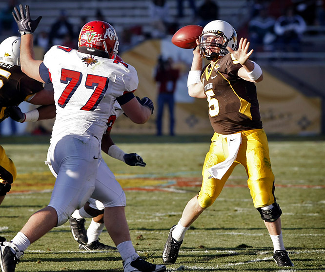 Wyoming trailed by 11 points in the fourth quarter, but freshman Austyn Carta-Samuels (left) threw three touchdown passes, the last a 13-yarder to David Leonard in the second overtime, and Wyoming rallied past Fresno State