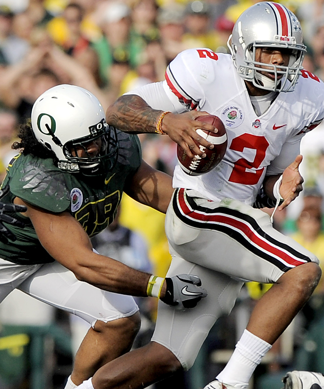 Terrelle Pryor (right) threw for 266 yards and two touchdowns and added 72 yards on the ground to lead No. 8 Ohio State. Jeremiah Masoli's 1-yard run gave No. 7 Oregon a 17-16 lead before the Buckeyes took the lead for good on Devin Barclay's 38-yard field goal late in the third quarter.