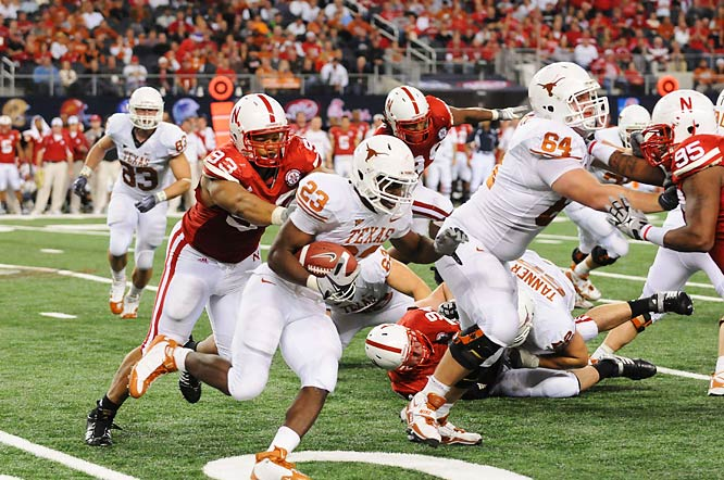 Defensive tackle Ndamukong Suh (93) of Nebraska chases down Tre' Newton.