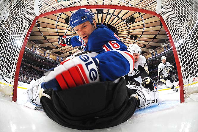 Brooks Orpik of the Pittsburgh Penguins propels Sean Avery of the New York Rangers over goaltender Marc-Andre Fleury at Madison Square Garden on Nov. 30. The Penguins defeated the Rangers 5-2.