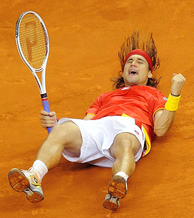 David Ferrer of Spain celebrates after defeating Radek Stepanek of Czech Republic in the second match of the Davis Cup  final at Barcelona's Palau Sant Jordi stadium on Dec. 4.