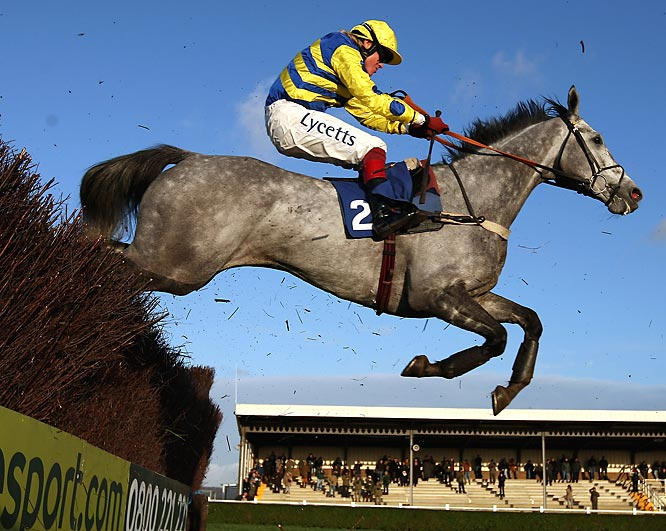 Bakbenscher, ridden by Robert Thornton, clears a fence on its way to winning the Weatherbys Bloodstock Insurance beginners Steeplechase at Wincanton Racecourse on Dec. 3 in Wincanton, England.